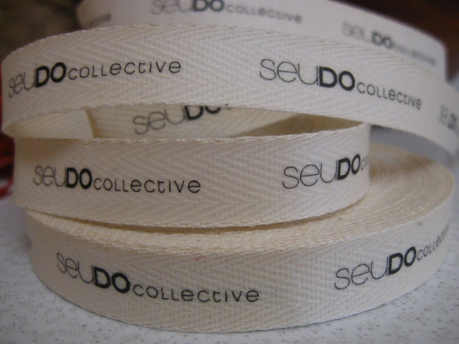 Twill Fabric Labels, three-eighths-inch ribbon, spool - uncut, natural or white - inkedpapers