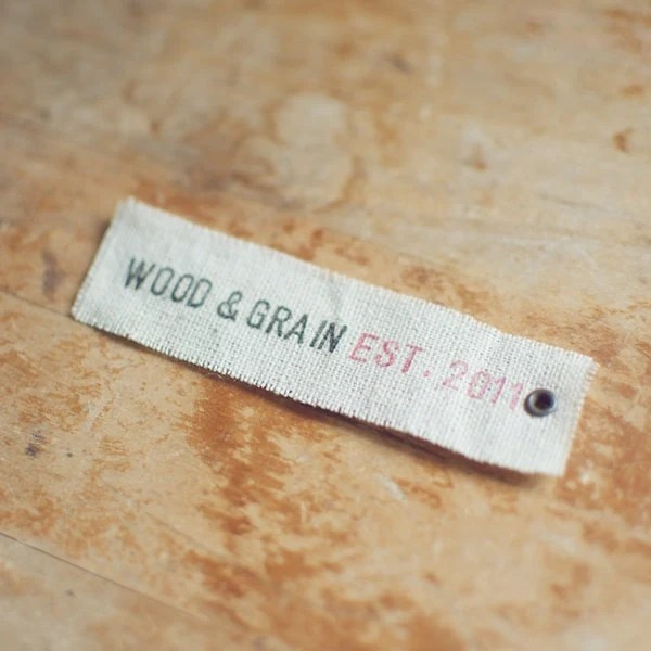 50 Linen Eyelet Labels Hand-Stamped with Custom 1 Line Message for Businesses - woodandgrain