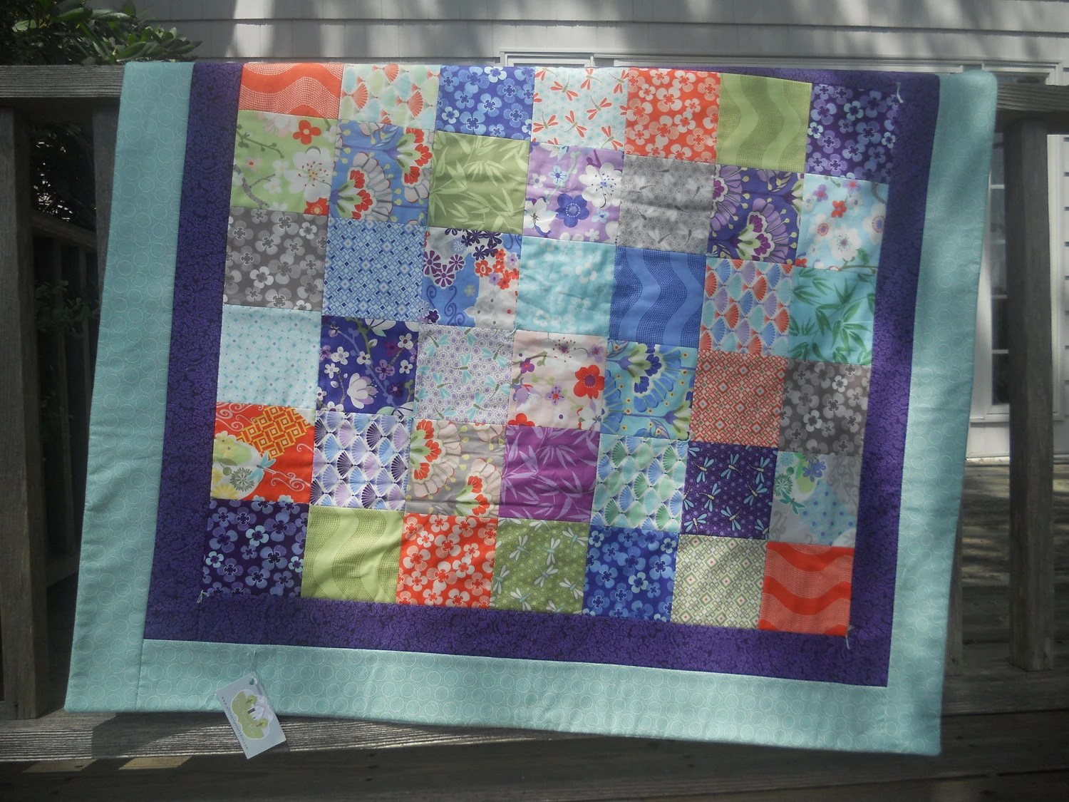 Baby or Lap Quilt in 'Good Fortune' fabrics Asian themed prints in fans, bamboo, dragonfly, floral in bright purple teal orange green blue