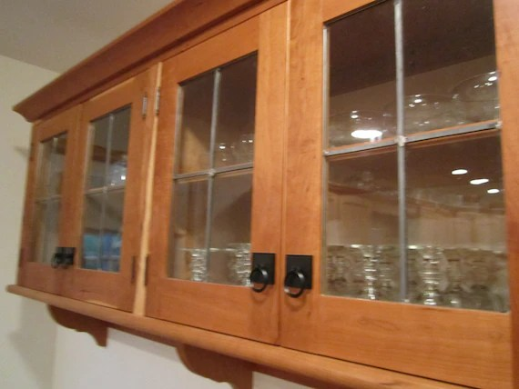 Custom Cherry Wall Cabinet With Leaded Glass Doors