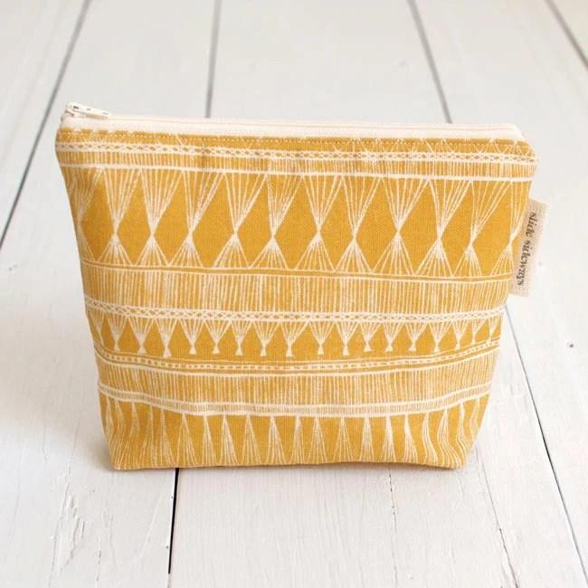 medium cotton zip pouch - Mustard Market Weave - SlideSideways