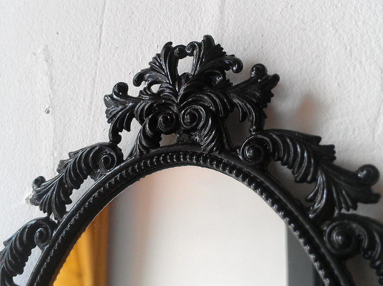Black Oval Mirror In Vintage Brass Feather Frame Gothic