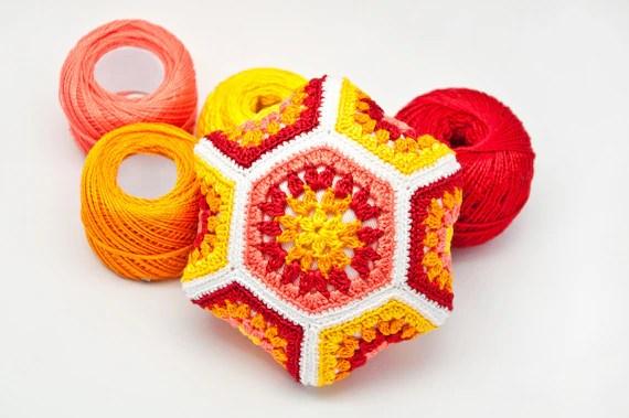 Crocheted pincushion, hexagon shape, cotton thread, bright colors, red, yellow, orange, handmade