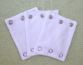 BODYSUIT EXTENDERS.  Add a size to your bodysuits. Also great for cloth diaper wearers.
