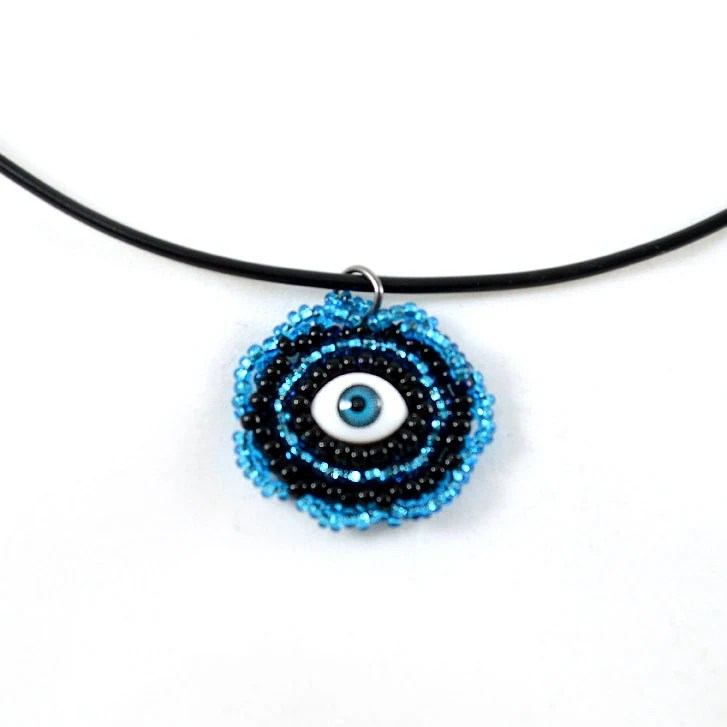 Black and Blue Eye Pendant Necklace on a Black Cord - MegansBeadedDesigns