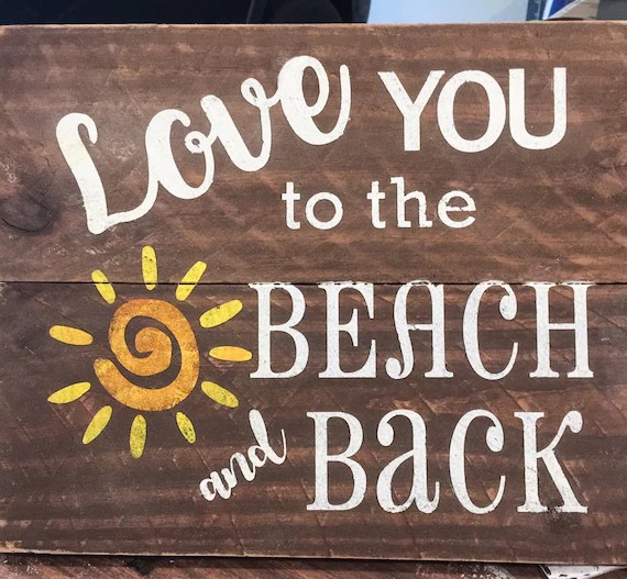 Download Sign Love you to the beach and back on rustic wood