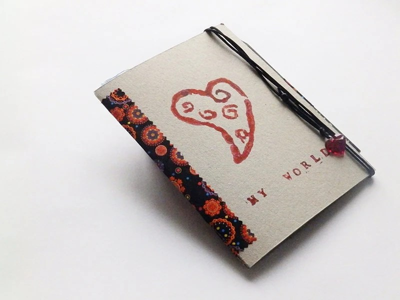 Notebook handmade with linocut design cover and details