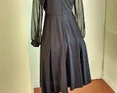 Vintage black dress by Al...