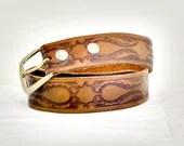 Tooled leather belt, genu...