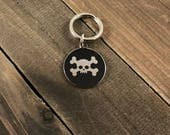 Crossbone dog tag • Cro...