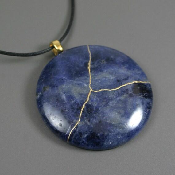 Kintsugi (kintsukuroi) sodalite round stone cabochon pendant with gold repair on cotton cord - OOAK