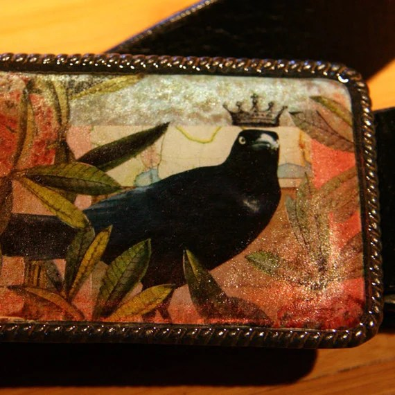 crow with a crown belt buckle