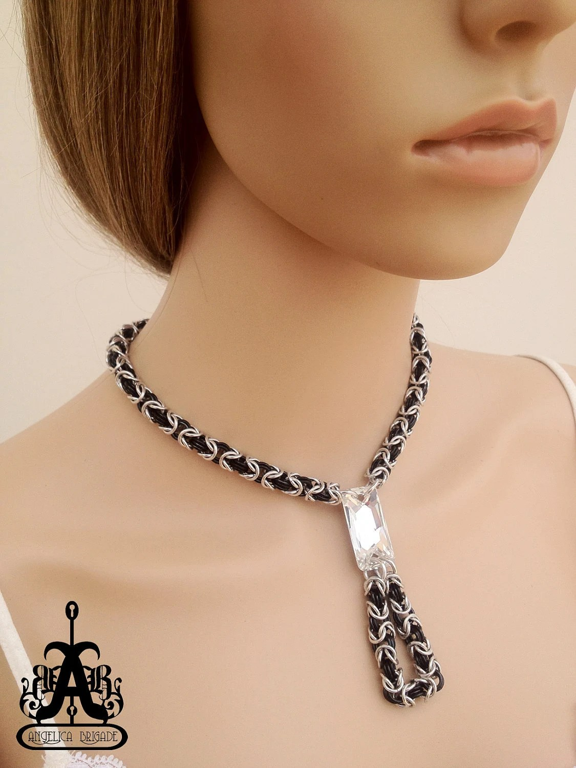Contemporary Chain Maille Necklace with a Large Swarovski Crystal Centerpiece, US$60 Made to order. http://www.etsy.com/listing/89827486/contemporary-chain-maille-necklace-with An original design by joyz*k of Angelica Brigade http://www.etsy.com/listing/89827486/