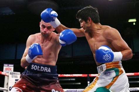 Indian boxing star Vijender Singh's rampaging winning streak remained intact as he carved out a sixth successive knockout victory by battering Poland's Andrzej Soldra. Fighting the first eight-round contest of his fledgling pro career, Vijender completed yet another dominating win barely a minute into the third round. (Getty Images)
