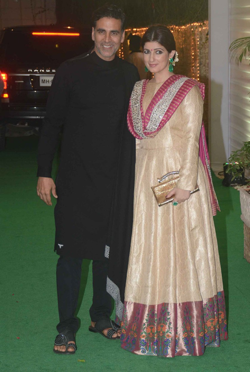Akshay Kumar poses with his wife Twinkle Khanna as they arrive for Ekta Kapoor's Diwali party hosted at her residence in Mumbai on October 17, 2017. (Image: Yogen Shah)