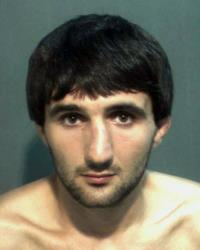 This 2013 police mugshot provided by the Orange County Corrections Department in Orlando, Fla., shows Ibragim Todashev.