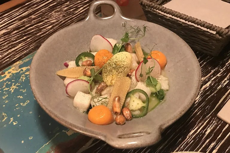 Local fish ceviche with a dollop of mango ice cream at Cana Kitchen and Bar