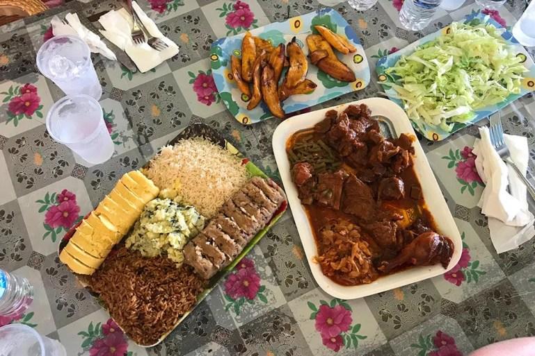 Family-style dining at Plasa Bieu indoor market