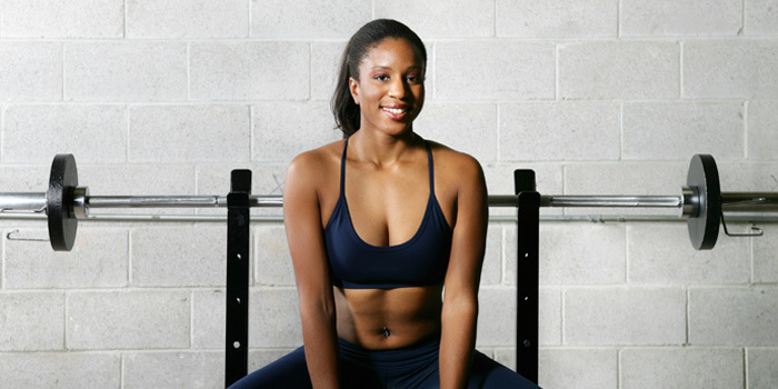 woman sitting on weight bench