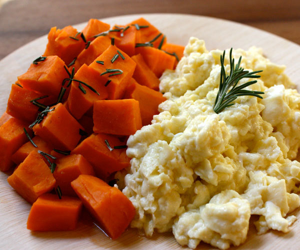 Scrambled egg whites with steamed sweet potato high-protein breakfast recipe.