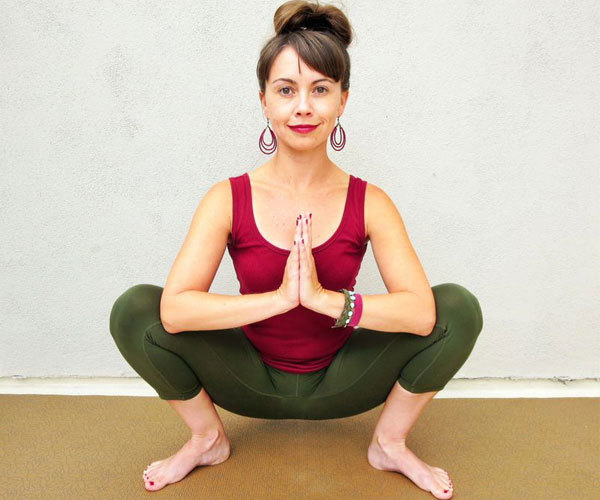 Beachbody Blog Garland Pose Hips