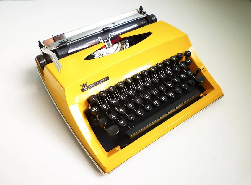 Vintage Contessa DeLuxe Yellow Typewriter Portable Manual Triumph Adler - EuroVintage