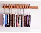 Custom made wooden book rack in Oak. The pins are also bookmarks. - OldAndCold