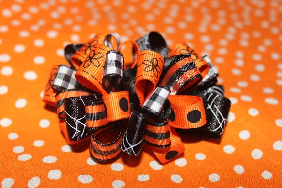 Loopy black and orange Halloween hair bow - SweetberryBoutique