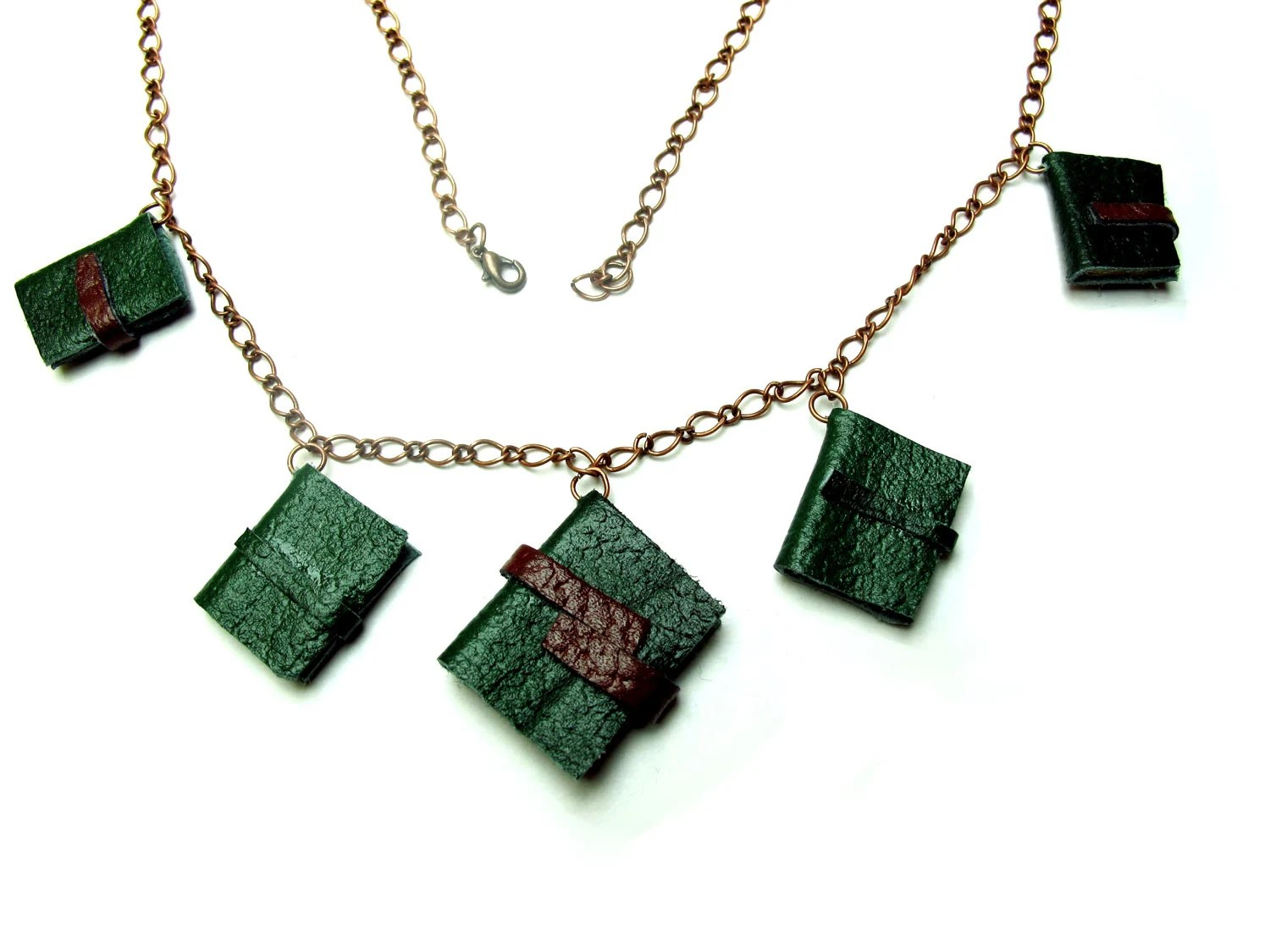 Mini book necklace, five dark green decorative leather journals on antiqued brass chain.