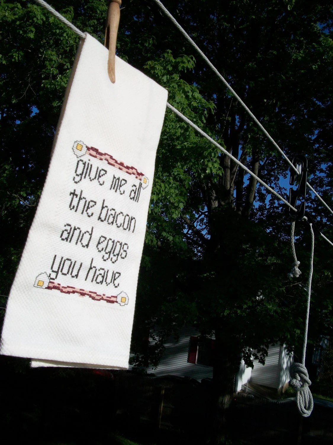 Cross stitched towel-- Give me all the bacon and eggs you have ($45.00) by aliciawatkins. So, this is a great item for anyone who loves Parks and Recreation. I mean, this quote from the show is a classic and the design matches perfectly. Her shop also features other fun cross stitch from TV shows.