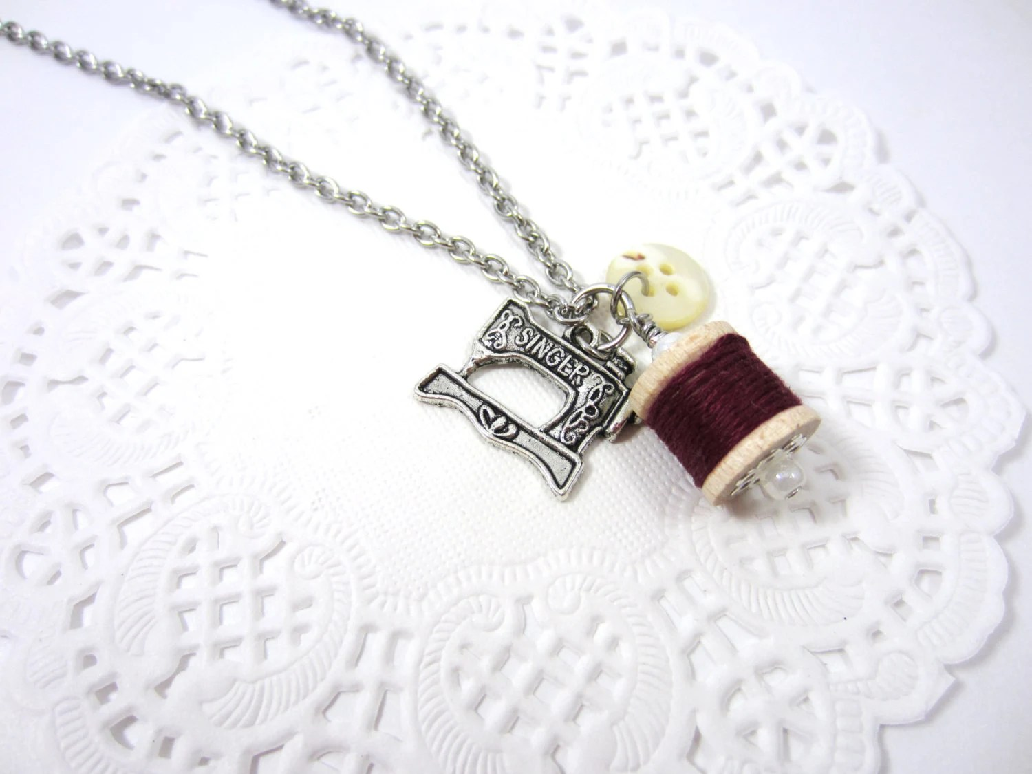 Le collier couture - Charm necklace with wooden spool, mother of pearl button and Singer sewing machine charm - Burgundy - MamzelleBouton