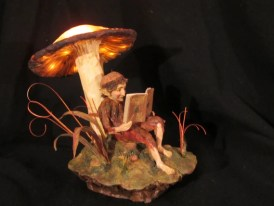 Faerie Reading Under a Mushroom by June Gallagher | September Artist of the Month on Kater's Acres Polymer Clay Blog