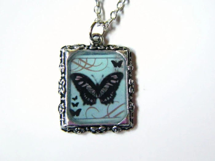 Black and blue butterfly resin pendant necklace - hellodarlingjewelry