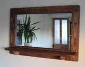 mirror with inbuilt shelf...