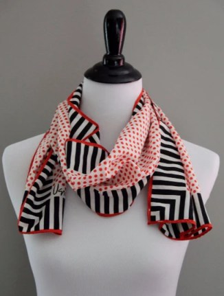 Red and white polkadot scarf with black and white stripes from Etsy. Get adventurous and try combining three prints!