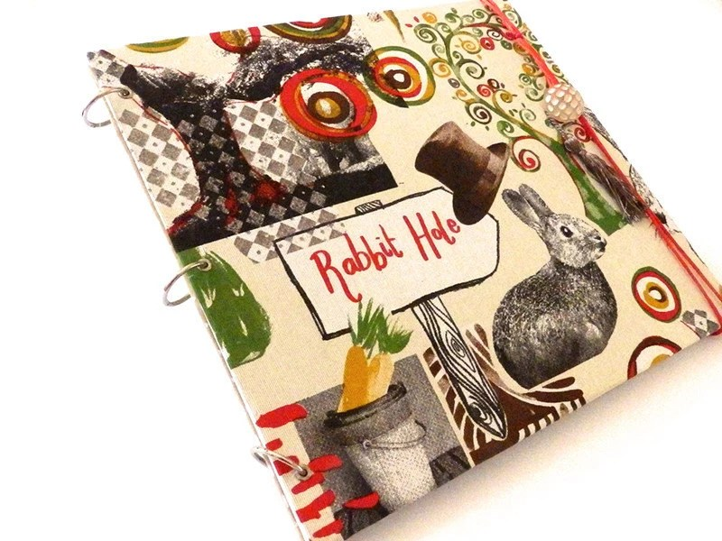 Photo album with magical rabbit fabric theme