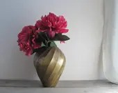 Solid brass vase with swi...