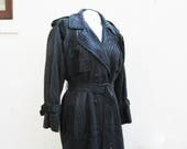Black leather trench coat...