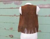 1970s Tasseled leather ve...