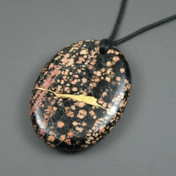Kintsugi (kintsukuroi) red snowflake jasper oval stone pendant with gold repair on black cotton cord - OOAK