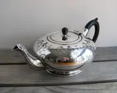 Antique teapot with eboni...