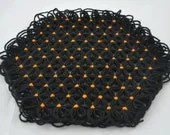 Small Trivet in 4 Layers of  Black Shimmer Yarn with Pumpkin Orange Ties - Halloween Colors