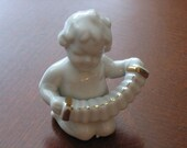 Baby Figurine Playing the Accordion Made in Japan