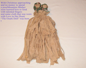 Ozark Primitive Doll holding her Baby.