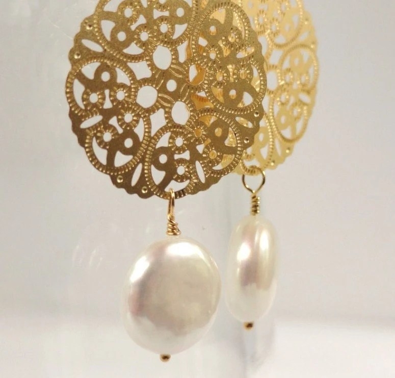 Mila   ...matte gold medallion and freshwater coin pearl drop earrings. Also available in matte silver.