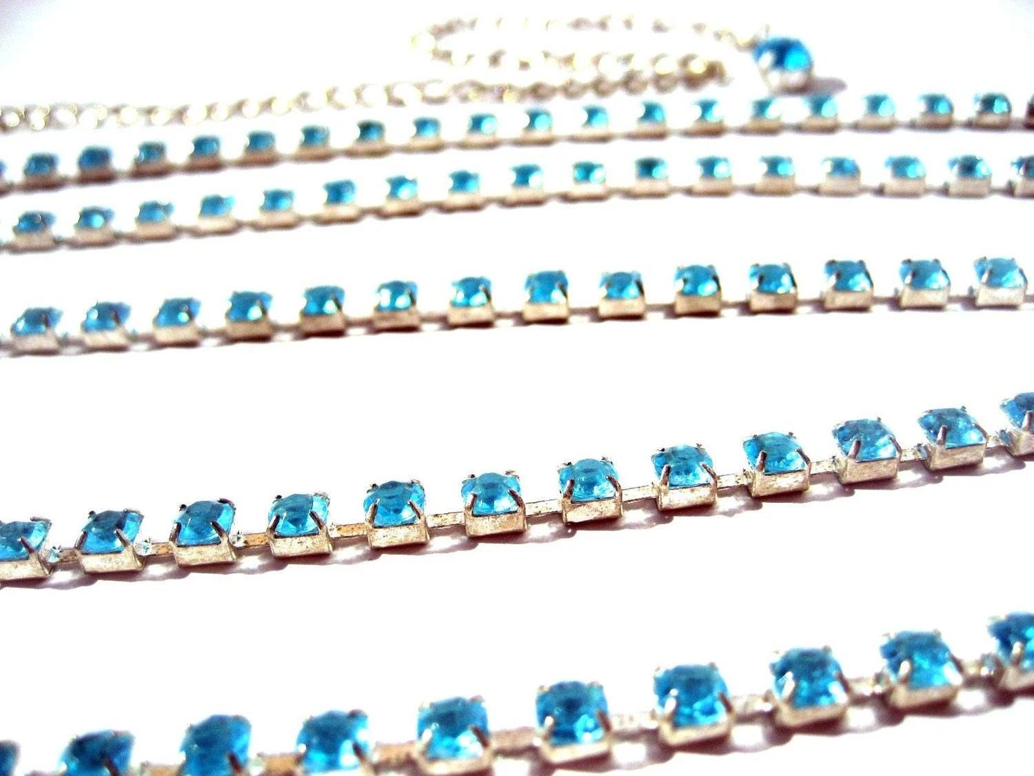 Vintage sparkling belt made row of more than one hundred deep light  blue rhinestones and single big rhinestone to end code A15