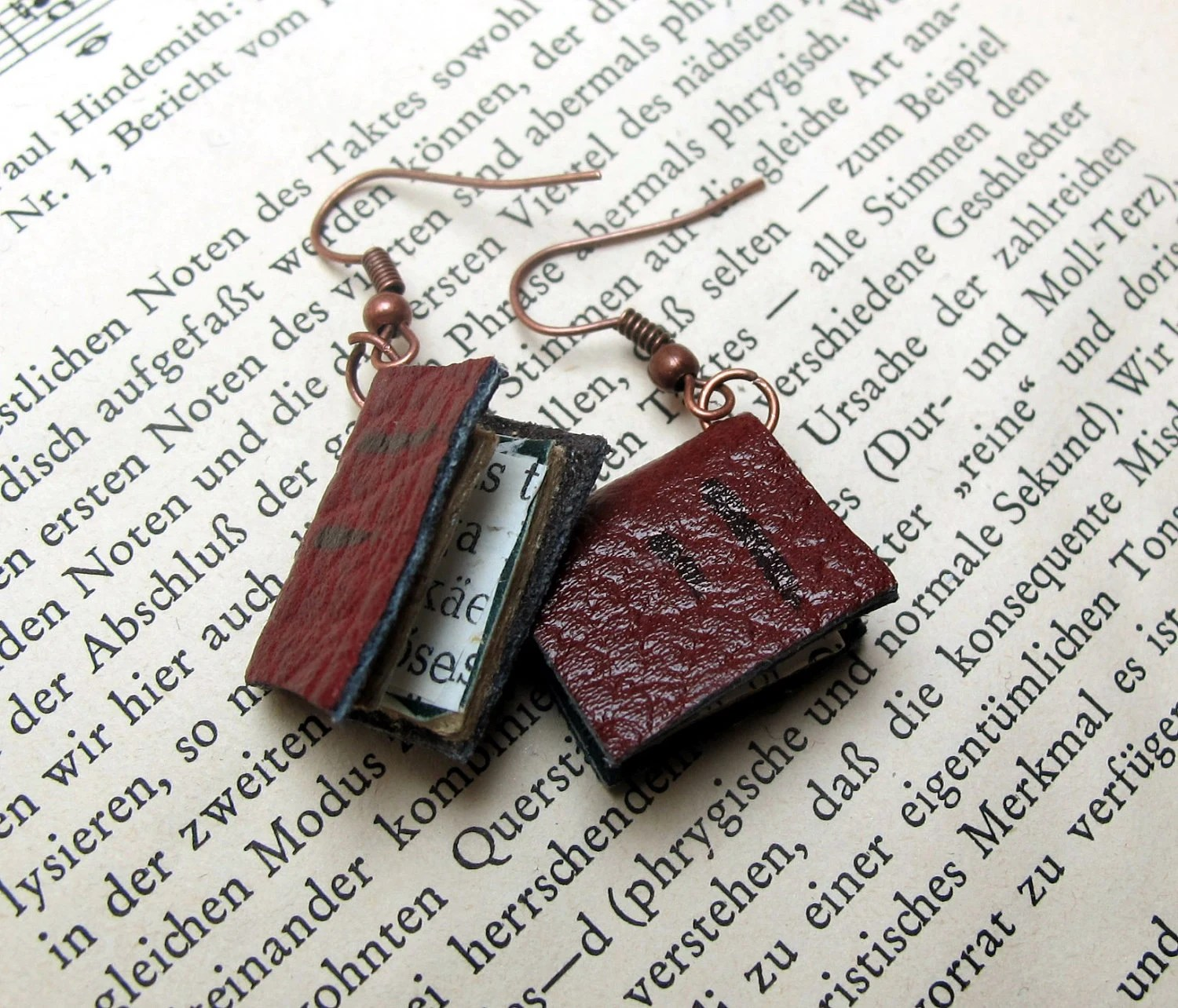 Dangle earrings, red/brown leather books