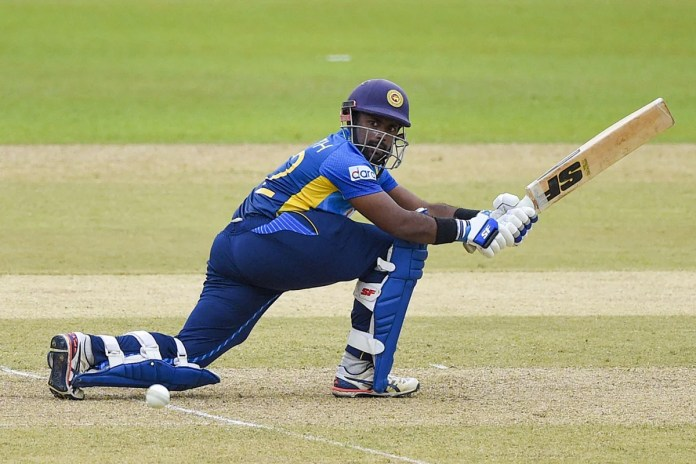 Charith Asalanka stretches out to sweep, Sri Lanka vs South Africa, 1st ODI, Colombo, September 2, 2021