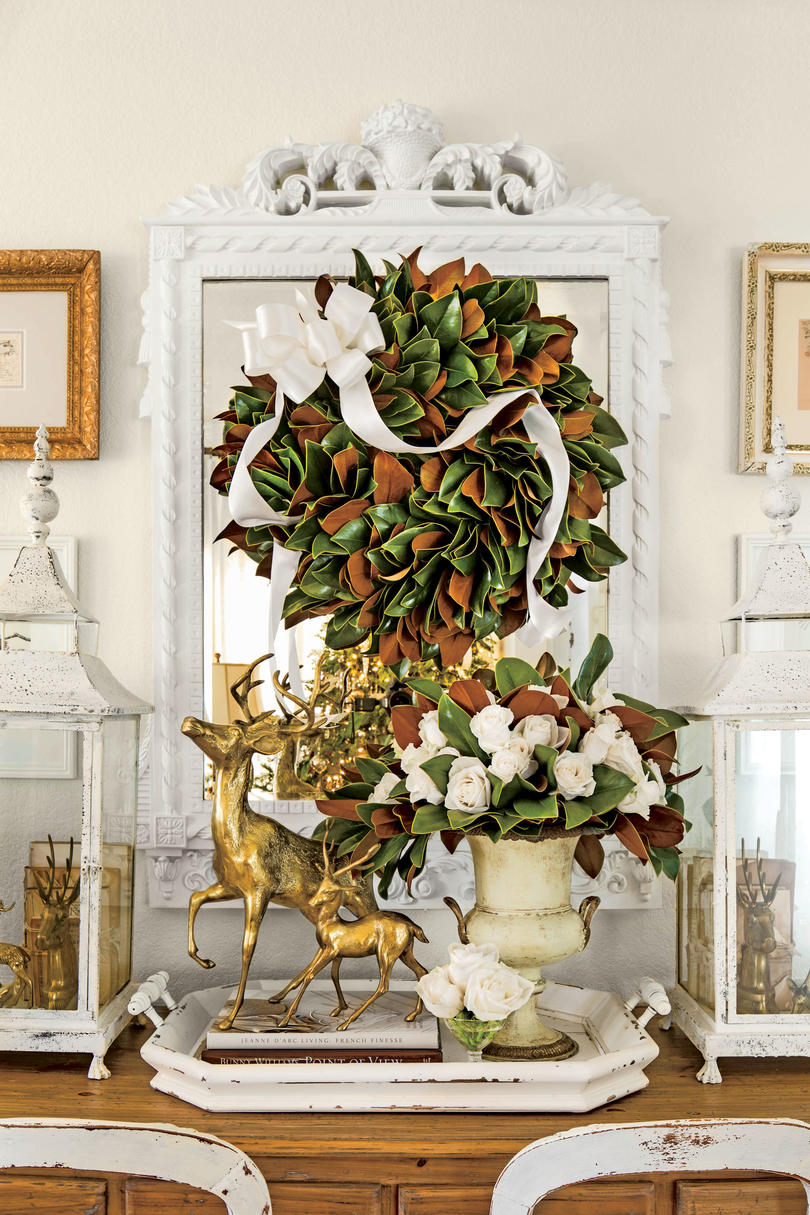 10 Ways to Decorate with Magnolia this Christmas   Southern Living Magnolia Wreath on Mirror with Bow