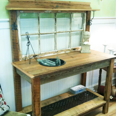 old window and wood salvaged into potting bench